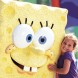 This is a picture of a child hugging Spongebob the character at great america amusement park